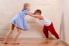 Boy and Girl Kids Playing at Home Royalty Free Stock Photography