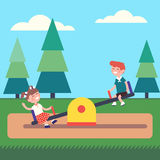 Boy and girl kids swinging on seesaw at the park Stock Images