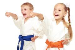 Boy and girl in kimono beat hand Royalty Free Stock Photos