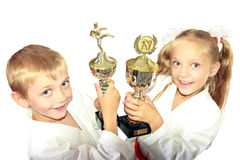 Boy and girl in a kimono with a championship winning in the hands of Royalty Free Stock Photography