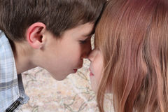 Boy and girl kissing Stock Image