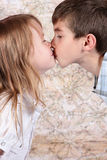 Boy and girl kissing. Each other - closeup Stock Photography