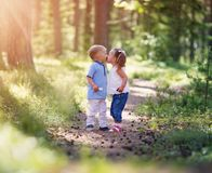 Boy and girl kissing in the forest Stock Photography