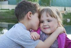 Boy and girl kissing. Stock Image