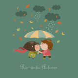 Boy and a girl kissing under umbrella Stock Photography