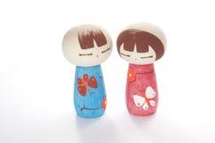 Boy and girl kokeshi. On white background Stock Photo