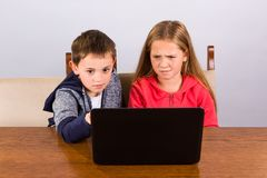 Boy and girl with laptop Stock Photo