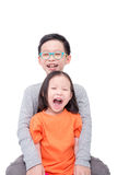 Boy and girl laugh over white background Royalty Free Stock Photos