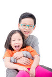 Boy and girl laugh over white background Stock Images
