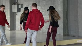 Boy and girl learn hip hop in dance studio. Couple of teenagers practicing contemporary dance. Hip hop generation stock video