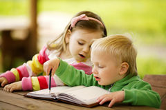 Boy and girl learning Royalty Free Stock Photo