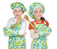 Boy and girl learning to cook. A over white background royalty free stock images