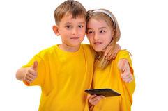Boy and girl like e-book Royalty Free Stock Photos