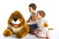 Boy, Girl and Lion Stock Images