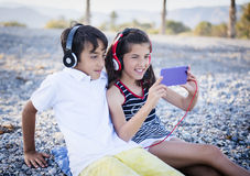 Boy and girl listening to music Royalty Free Stock Image