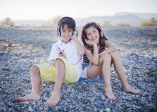 Boy and girl listening to music Stock Photo