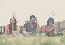 Boy and girl  listening to music Stock Photos