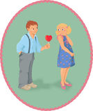 Boy, girl and a lollipop look like heart shape - V Royalty Free Stock Photo