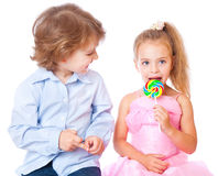 Boy and girl with lollipops Royalty Free Stock Photo