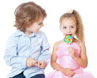 Boy and girl with lollipops Royalty Free Stock Image