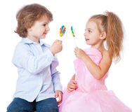 Boy and girl with lollipops Stock Image
