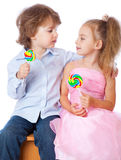 Boy and girl with lollipops Stock Photo