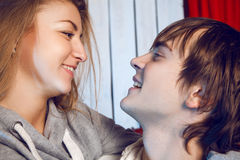 Boy and girl look at each other with loving eyes. Indoors Royalty Free Stock Images