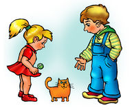 Boy and girl look at kitten Stock Photo