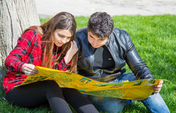 Boy and girl look at map Royalty Free Stock Photography