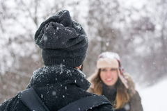Boy and girl looking at each other in the snow Stock Photos
