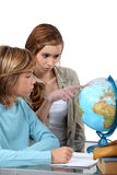 Boy and girl looking at a globe Stock Image