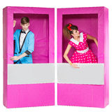 Boy and girl looking like dolls in boxes Stock Images