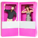 Boy and girl looking like dolls in boxes Royalty Free Stock Images