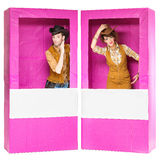 Boy and girl looking like dolls in boxes Stock Photos