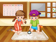 Boy and girl looking at the map Stock Images