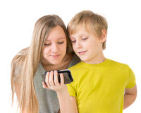 Boy and girl looking at phone Stock Photo