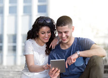 Boy and girl looking at tablet Royalty Free Stock Photos