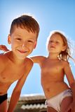 Boy and girl looks into the camera Royalty Free Stock Photos