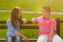 Boy and girl in love looking at each other royalty free stock photo