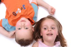 Boy and girl are lying on the floor Stock Image