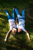 Boy and girl lying on the grass. Royalty Free Stock Photography