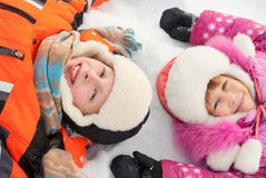 Boy and girl lying on the snow Royalty Free Stock Photography