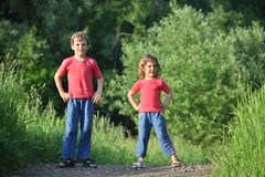 Boy and girl make gymnastic in park Royalty Free Stock Images