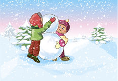 Boy and a Girl make a Snowman Royalty Free Stock Images