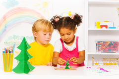 Boy and girl making forms of playing dough Royalty Free Stock Photos