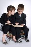 Boy and girl making homework Stock Photography