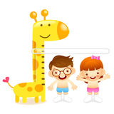 The boy and girl measure one's height. Education and life Charac Royalty Free Stock Images