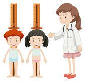 Boy and girl measuring height Stock Image