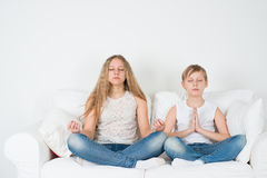 Boy and girl meditate Stock Photography