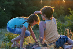 Boy and girl at the nature. Boy and girl playing at the nature royalty free stock photography